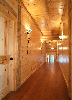 ... tongue & groove knotty pine paneling, with log rafter on ceiling