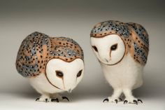 This is a sculpture of two needle felted Barn owls perched upon a sycamore branch.   <3
