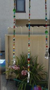 beaded sun catchers - hung in front of large sliding doors or picture windows they also can prevent birds from flying into the windows