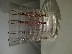 Celtic knot earrings in copper and silver