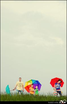Creative Assignment #2: #M1fs4233 Negative space is being used in this family portrait as a creative stand point. The family members all have bright colors and fun colored umbrellas. The negative space which is the dark, grey sky is used as back drop to make the family stand out in the bottom.