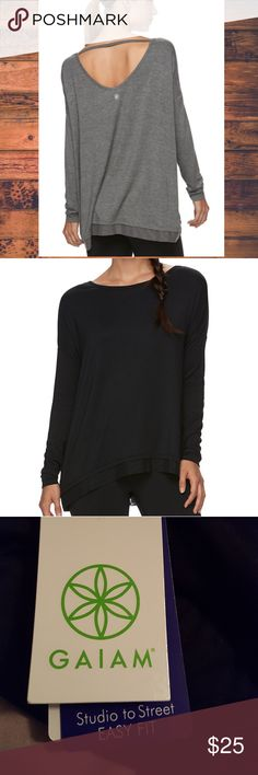NWT BLACK Gaiam Nirvana Drop-Shoulder Yoga Tunic Cozy comfort meets stunning style with this women's Nirvana tunic from Gaiam. The bar-back detail and mesh hem add trendy appeal to this otherwise laidback look.  Drop-shoulder design, Open back with bar detail, High-low hem with mesh trim,Tag-free, Scoopneck, Long sleeves  This is in BLACK, same back as gray photo.  It is a size SMALL but because of the cut, a MEDIUM could wear it as well!!! Gaiam Tops