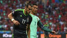 Bale and Ronaldo compete for the ball during Portugal's 2-0 win