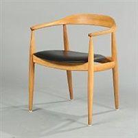 An elm armchair by Illum Wikkelsø