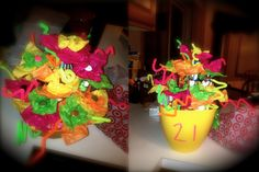 A Bouquet of Booze!  Mini bottles of alcohol wrapped in tissue paper to look like flowers in a pot thats filled with candy.