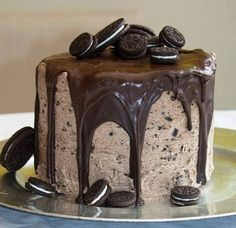 chocolate pound cake with a delectable Oreo sweet cream cheese and hardened melted chocolate drizzle? ill take two! For more awesome ideas like this and other amazing galleries please check out http://pics.funnierpics.net/ddesserts-jpg-2-1.html