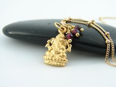 Ganesh Garnet Necklace -24kt gold vermeil  Gook Luck Wealth Wisdom -Love Devotion- Yoga Jewelry. $95.00, via Etsy.