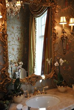 beautiful white orchards in the bathroom, ornate gilt mirror