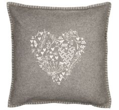 Love the intricate embroidery on this cushion!