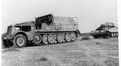 A Afrika Corp Famo SdKfz 9 18 ton halftrack towing a British Crusader tank captured in North Africa for evaluation.