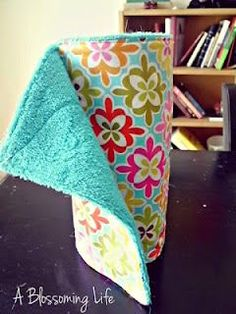 DIY Reusable Paper towels- go green & save $$ we use old receiving blankets and cut up old towels but I'd love to make some pretty ones:)