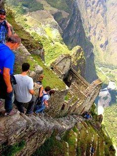 Vertical stairs at Machu Picchu Peru don't miss  a step!