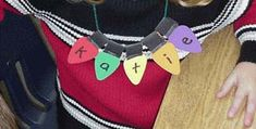 Use  die cut lights to make name necklaces or decoration for the classroom tree!