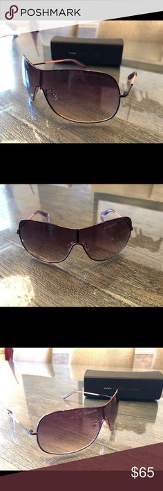 Marc by Marc Jacobs Sunglasses Marc by Marc Jacobs sunglasses worn only once. Mint Condition. Stunning purple color! Absolutely beautiful! Marc By Marc Jacobs Accessories Sunglasses