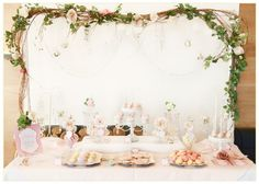 Love the branch and flower garland dessert table display