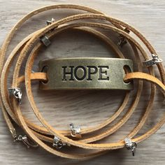 Newest wrap bracelet in the shop. Delicate silver stars on leather, and a brass plate with the word Hope, simply boho!