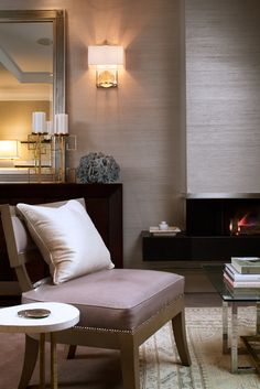 Love the grass cloth wall color with dark wood and champagne colored wall.