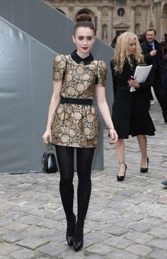 Lily Collins at Louis Vuitton Fall/Winter in a brocade floral print. Prints in street style.