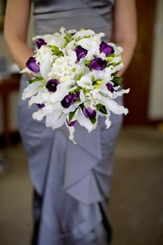 Bouquet w/ white Oriental lilies, hyacinths and freesias.