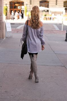 amber from every once in a style wearing grey off the shoulder top and over the knee grey boots