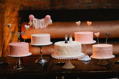 table with one tiered cakes - photo by Shannen Natasha - http://ruffledblog.com/metropolitan-garden-wedding/