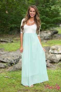 We adore these versatile maxi dresses! With lightweight and breathable fabric, 3/4 sleeves, and a timelessly elegant look, they are perfect for any occasion and any season! This maxi features off white at the top, a mint chiffon overlay on the skirt, and a mint lining.
