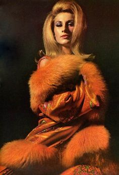 Jane Holzer wearing a fiery coat with Mongolian lamb fur trim