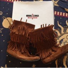 For sale, comment: Minnetonka 3- Layer Fringe Boot Worn a few times. Almost perfect condition minus small stitch inside right foot (picture posted). The stitch is easily fixable. Comes with original box. Minnetonka Shoes