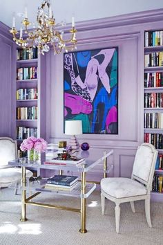 Some designs look better with coordinating wall and trim color, like this light purple lavender home office and library. Coordinating wall and trim color is an elegant look and brings the attention to the whole room. Keep reading and learn eight examples to use as inspiration to prove that you can paint the walls and trim in your home the same color—Hadley Court Interior Design blog.