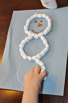 Preschool Christmas Craft... Mini marshmallow snowman... I would allow the kids to draw the faces.