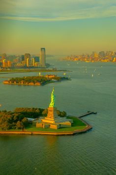 NYC. Statue of Liberty //  by Paco López-It looks like it's taken from a helicopter. That's Ellis Island in the background and that is the Hudson River .