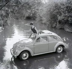 Fly fishing in England in a VW Beetle, mid 1960's, by unknown.