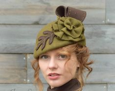Olive Green Tilt Fedora Hat - by Jaya Lee Designs  My inspiration for this jaunty little fedora hat came as I was studying fashions illustrations from the 1940s. All the ladies looked so glamorous in their little tilt hats and tailored suits I wanted to bring those hats back!!! The hat is made from vintage olive green felt. It has a very small crown (21) and is designed to sit at a slight right tilt on top of the forehead. The hat has a short brim that flips up in the back. The hat is…