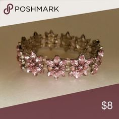 "🎉HP🎉 Pink Rhinestone Bracelet This bracelet has 11 pink rhinestone flowers strung on elastic for easy wearing.  Measures almost an inch wide and approximately 2.5"" in diameter.  🎉🎉Host Pick ""Best in Jewelry & Accessories"" 🎉🎉 Jewelry Bracelets"