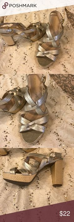 Franco Sarto size 8 1/2 gold strappy sandal Franco Sarto size 8 1/2 Gold Strappy Sandal. In great condition. These are not a bright gold - they are a brushed gold in color. Franco Sarto Shoes Sandals