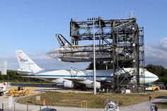 April 15, 2012 -  Shuttle Carrier Aircraft (SCA) NASA-905 is positioned beneath Space Shuttle Discovery in the mate-demate device at Kennedy Space Center in Florida. The orbiter was mated to the modified 747 for its flight to Washington, DC on April 17, 2012.     NASA Photo: KSC-2012-2218