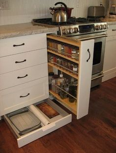 Spice rack drawer (instead of lazy suzan?)    Claim unused space in the supporting platform under base cabinets by outfitting the toe-kick area with broad drawers for platters and baking supplies