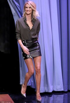 True Mad Max style: Rosie Huntington-Whiteley wore a studded leather mini skirt and a pair...