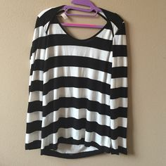 Forever 21 striped top size M Cute top that I maybe only wore once. Size M from F21.  It features a cut out on the back, but you can always add a cami if you want. Forever 21 Tops Blouses