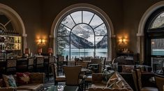 """""""Fairytale scenes at the Fairmont Chateau Lake Louise. Hard to imagine a more beautiful spot to warm up and enjoy a drink. Fairmont Chateau Lake Louise, Drink Photo, Canadian Rockies, Banff National Park, Plan Your Trip, Rocky Mountains, Fairy Tales, Castle, Warm"""