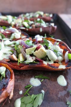 Delicious stuffed sweet potato skins with a refreshing cilantro sauce! The perfect appetizer that you can prepare ahead of time and reheat at the last minute!