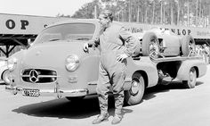 Test driving at the Hockenheimring in 1955: Rudolf Uhlenhaut next to the Mercedes-Benz racing car transporter with a W 196 R on the load are...