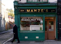George Mascall at the Manze's Pie and Mash cafe, open since 1890 and passed down through four generations of family, on Deptford High Street...