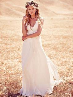 18 Romantic Bomemian Chic Summer Wedding Dresses for The Modern Boho Princess: Beautiful spaghetti straps boho chic summer wedding dress with crochet top and flowy skirt