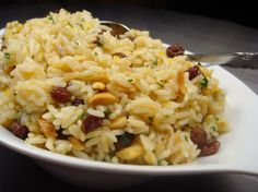 Orange Persian Rice  substitute cranberries for raisins  wash the rice repeatedly for fluffy rice!