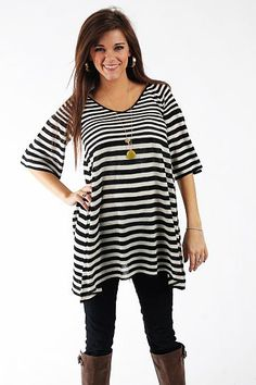 "Striped Babydoll Top, Black $48.00  How cute is this top? Horizontal black and white stripes are always in style, and we love the fit of this! The bell sleeves are half length, the hemline is asymmetrical and we love how this piece flares out from the top for a draped fit.   Fits true to size. Miranda is wearing a small.   From shoulder to hem:  Small - 31""  Medium - 32""  Large - 33"""