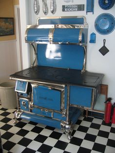 51 Best Ideas For Wood Kitchen Blue Stove Wood Burning Cook Stove, Wood Stove Cooking, Kitchen Stove, Kitchen Wood, Cheap Wood Flooring, Wood Tile Floors, Antique Wood Stove, How To Antique Wood, Vintage Wood