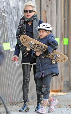 Growing up so fast: Matilda Ledger, seen on Saturday in Brooklyn with mom Michelle Williams, is taking after her late father Heath Ledger by...