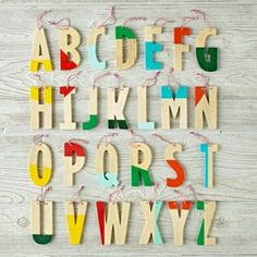 Create a more vibrant holiday with our Color Dipped Letter Ornament. Each wooden letter features a bright pop of color and is topped with a hanging string.