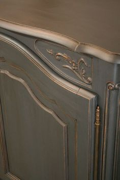 Graphite Chalk Paint, distressed edges, showing wood underneath . Annie Sloan clear wax and a thinned dark wax with mineral spirits to make a glaze that deepened the graphite.